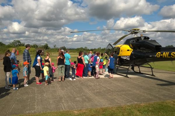 A queue to visit the helicopter